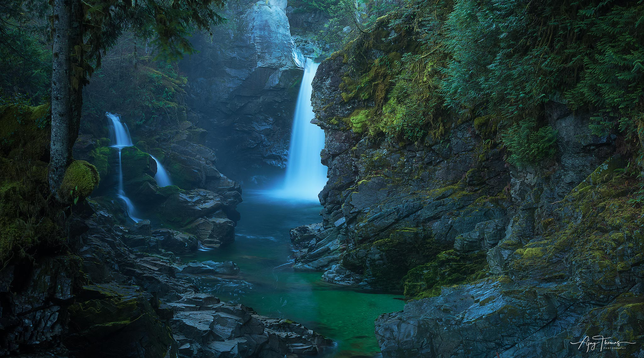 A hidden waterfall near sea to sky highway deep in the forest of  Squamish, BC . Popular for kayaking and cliff jumping . one...